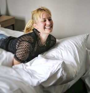 Adina Apartment Hotel, berlin, checkpoint charlie, smile, blonde, girl, black shirt, bed