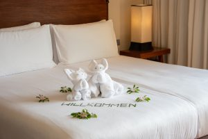 Phuket, Thailand, Paresa Resort, hotel room, hotel bed, bed, sheets, white, flowers, welcome